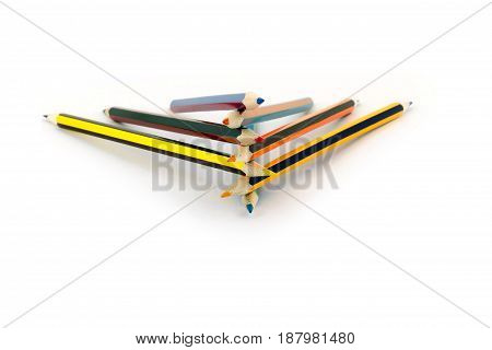 Colored Pencils Lie On Top Of Each Other Isolated On White Background