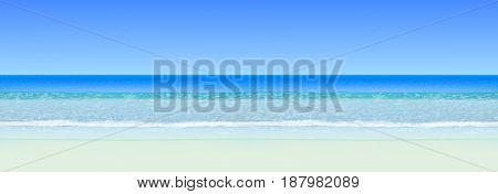 Realistic vector seascape. Calm sea (ocean) with horizon, beach with white sand and blue sky. Horizontal seamless background.