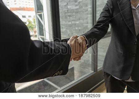 Business partnership handshake for deal business project, Business success concept, soft focus, vintage tone