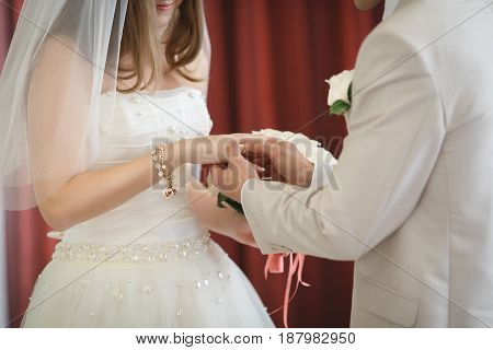 Bridegroom Puts The Ring On The Bride