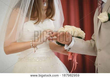 The Bride And Groom Put On Wedding Rings.