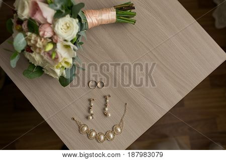 The Wedding Rings Lie On The Table.