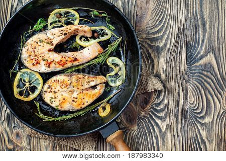 Salmon Steak, Fried With Herbs, Pepper And Lemon