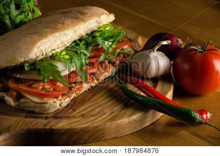 Delicious sandwich with ciabatta fresh vegetables and tomatos