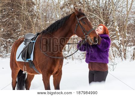 Woman With Red Hair And Big Horse Outdoor In Winter