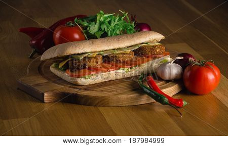 Delicious sandwich with fresh vegetables and tomatos