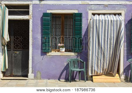 Detail of violet house of Burano island, Italy