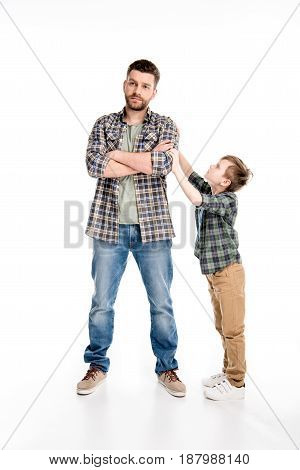 Little Boy Trying To Talk With Father Standing With Crossed Arms, Family Problems Concept
