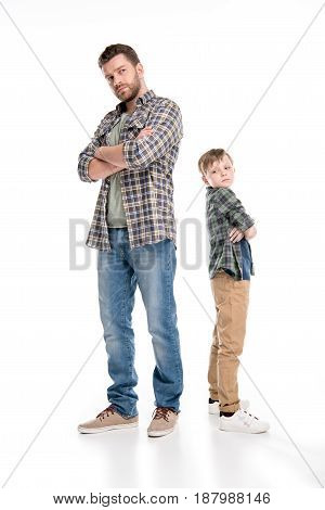 Full Length View Of Serious Father And Son Standing With Crossed Arms, Family Problems Concept