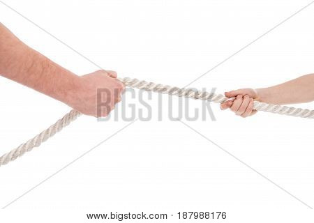 Close-up partial view of father and son pulling rope family problems concept