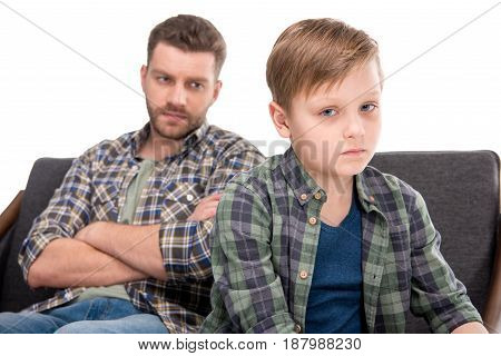 Serious Father With Crossed Arms Looking At Upset Little Boy, Family Problems Concept