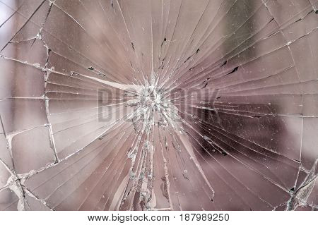 Texture of broken glass. Broken window glass. Chipped automotive glass. Cracks on the mirror. For photomontage and collage.