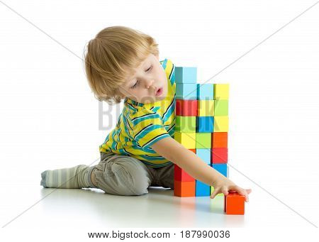 kid toddler playing wooden blocks toy isolated on white