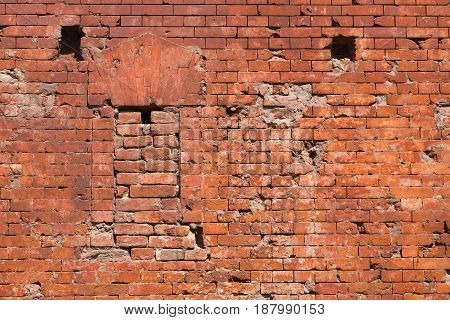 Fragment of the brick wall of the fortress with embrasure. Architecture fortification exterior