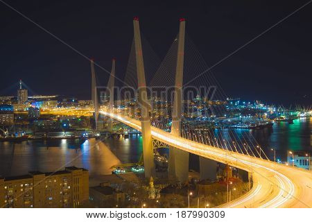 view the city at night, the bridge across the Bay at night, full of bright lights. .Golden Bridge