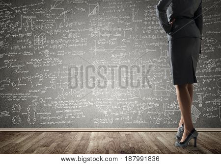 Bottom view of businesswoman or teacher and sketches at blackboard
