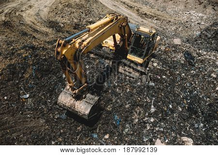 Excavator Working In Dump Site. Industrial Details Of Machinery Working And Digging