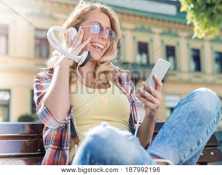 Woman listening to music.People leisure and technology concept.