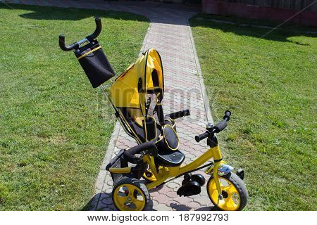 yellow bicycle pedal for kids in the yard