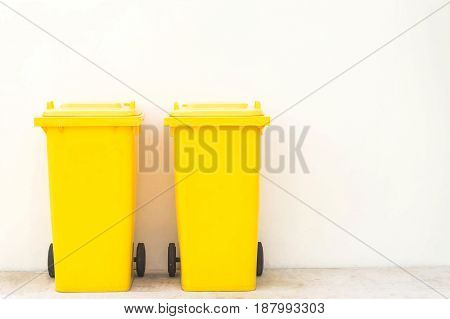 Yellow bins in the park / Wheeled garbage cans on the street.