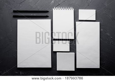 Corporate identity template stationery on dark grey concrete texture. Mock up for branding graphic designers presentations and portfolios.