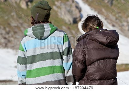 Couple in the mountains during summer vacations. Caucasus 2010