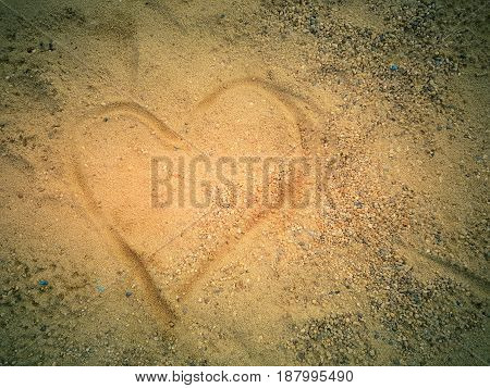 Heart drown on sand beach and shadowRomantic background.