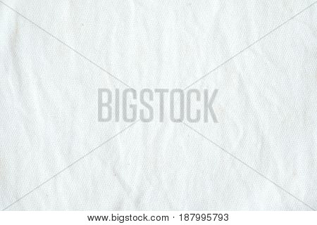 Wrinkled white cotton fabric texture background wallpaper