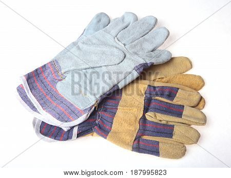 Two Pair of protective work gloves isolated on a white background