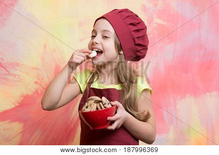Girl Chef Or Child Cook In Hat Eating Cookie Food