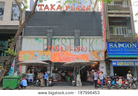 HO CHI MINH CITY VIETNAM - NOVEMBER 28, 2016: Unidentified people visit Taka Plaza. Taka Plaza is a long established shopping mall in downtown Saigon.
