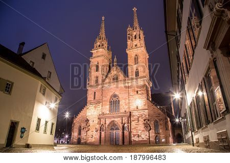 Exterior view of the illuminated Basel Minster at night