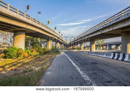 Road under the bridge and sky view.