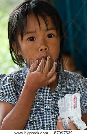 CHIANG MAI THAILAND - OCTOBER 23 : unidentified children eat snacks in their village on OCTOBER 23 2009 in CHIANG MAI THAILAND