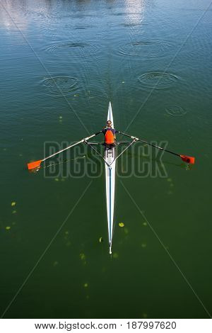 Young woman rowing in boat on the lake