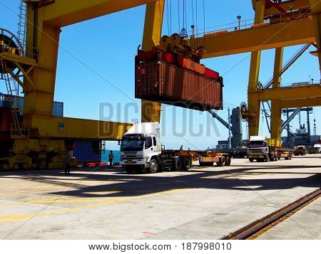 Loading container to the trailer at port.
