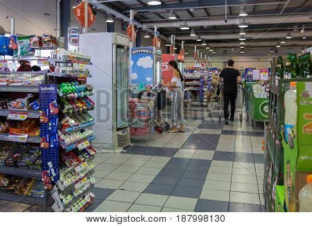 ASHDOD ISRAEL - MAY 23 2017: Undefined people walking with shopping carts at israeli supermarket