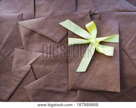 many envelopes from Kraft paper old paper as a background in full space for text background book cover
