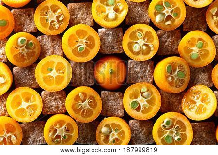 Slices Of Kumquat With Pieces Of Brown Sugar, Top View