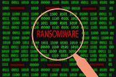 Magnifying glass enlarging ransomware in computer machine code poster