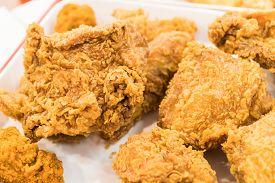 Fried chicken wings on wooden table. Breaded Crispy fried kentucky chicken tasty dinner