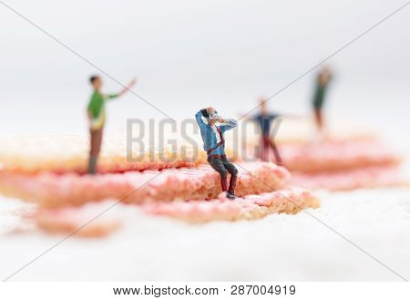 Miniature People, Photographer Seated Taking Pictures In Crowd