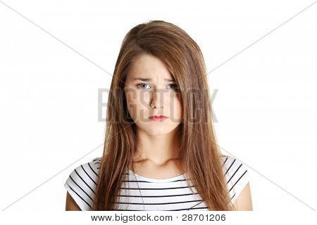 Portrait of a young sad female caucasian teen, on white.