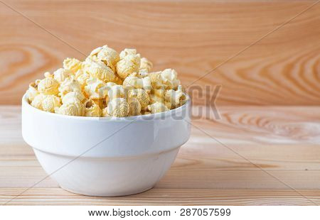 Air Salty Popcorn. A Bowl Of Popcorn On A Wooden Table.salt Popcorn On The Wooden Background . With