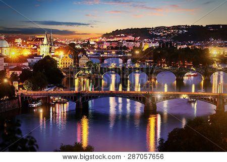 View Of Illuminated Bridges In Prague In Evening