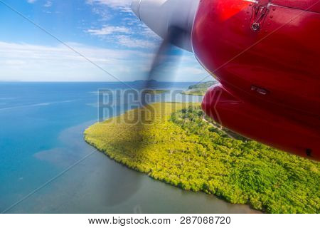 Air Travel In Fiji, Melanesia, Oceania. View Of A Green Remote Tropical Island From A Window Of A Sm