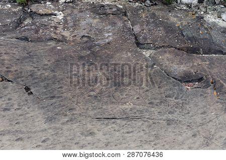 Altai Republic, Russia - June 8, 2018: Rock Petroglyphs In The Tract Kalbak-tash. Petroglyphs Of Dif