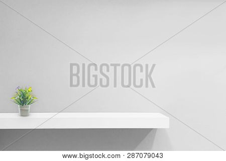 Empty White Shop Shelf, Retail Shelf On Grey Vintage Background.