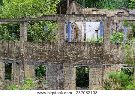 Building Ruins In A Forest. Ribeiro Frio On Portuguese Island Of Madeira