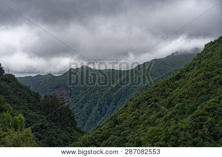Forested Mountains Against Cloudy Sky. View From Balcoes Viewpoint In Ribeiro Frio On Portuguese Isl